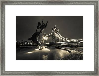 Tower Bridge And Dolphin Framed Print by Ian Hufton