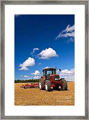 Tractor In Plowed Field Framed Print by Elena Elisseeva