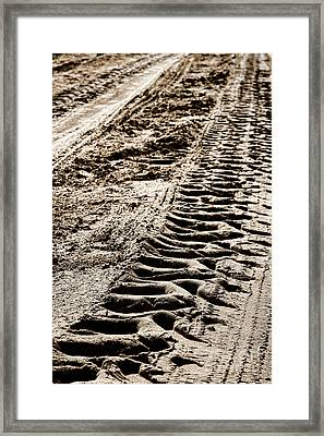 Tractor Tracks In Dry Mud Framed Print by Olivier Le Queinec