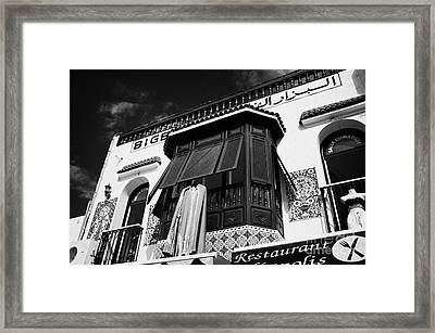 Traditional Blue Painted Window Shutters Above Market Shop In Nabeul Tunisia Framed Print by Joe Fox