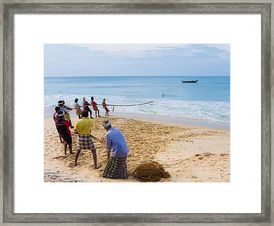 Hoisting The Nets Framed Print by Nila Newsom