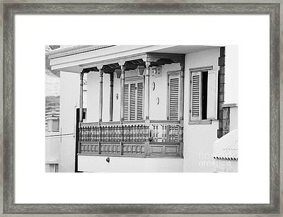 traditional wooden balcony on an apartment with orange paint and security alarm in La Laguna Tenerife Canary Islands Spain Framed Print by Joe Fox