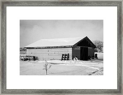 traditional wooden plank barn in rural village Forget Saskatchewan Canada Framed Print by Joe Fox