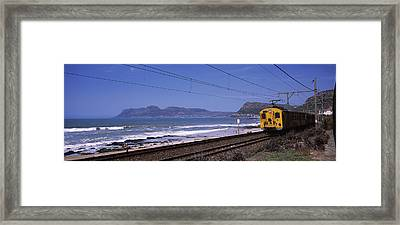 Train On Railroad Tracks, False Bay Framed Print by Panoramic Images