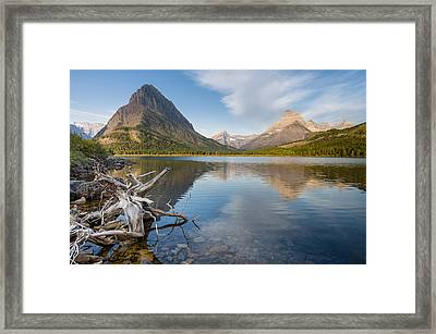 Tranquil Morning On Swiftcurrent Lake Framed Print by Greg Nyquist