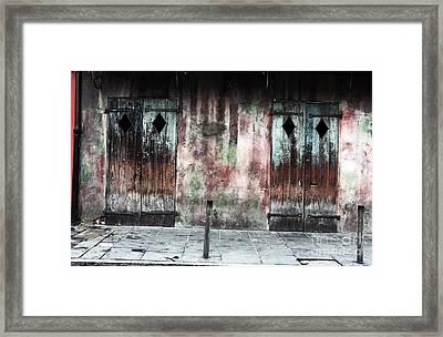 Triangle Doors Framed Print by John Rizzuto