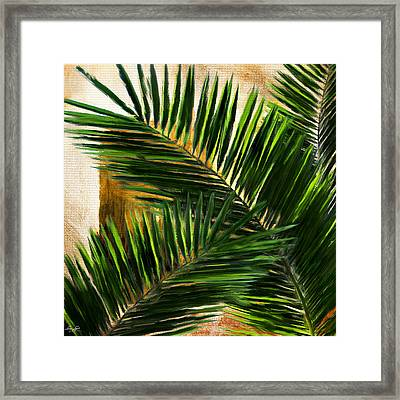 Tropical Leaves Framed Print by Lourry Legarde