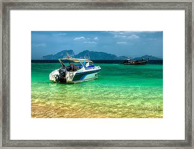 Tropical Travel Framed Print by Adrian Evans