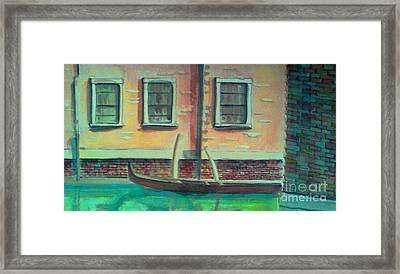 Tucked Into The Canal Framed Print by Rita Brown