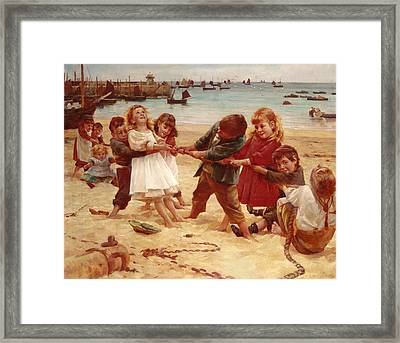 Tug Of War Framed Print by Edward R King