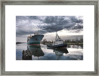 Tugboat Pulling A Cargo Ship Framed Print by Olivier Le Queinec