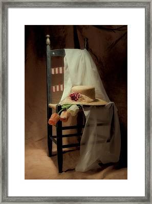 Tulips On A Chair Framed Print by Tom Mc Nemar