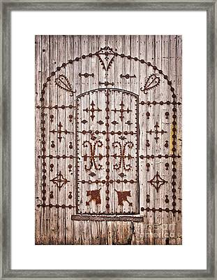 Tunisian Door Framed Print by Delphimages Photo Creations