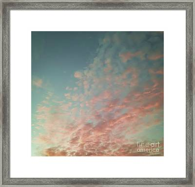 Turquoise And Peach Skies Framed Print by Holly Martin