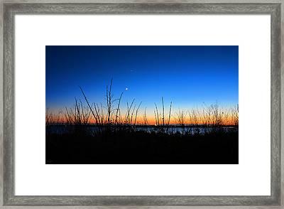 Twilight Moment Framed Print by Lourry Legarde