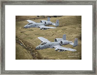 Two A-10 Thunderbolt IIs Conduct Framed Print by Stocktrek Images