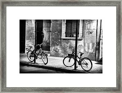 Two Bikes At Night Framed Print by John Rizzuto
