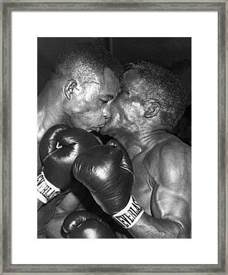 Two Boxers In A Clinch Framed Print by Underwood Archives