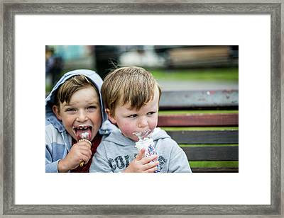 Two Boys Eating Ice Creams Framed Print by Samuel Ashfield
