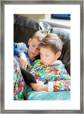 Two Boys Using A Digital Tablet Framed Print by Samuel Ashfield