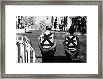 two carabineros de chile national police officers with roads closed Santiago Chile Framed Print by Joe Fox