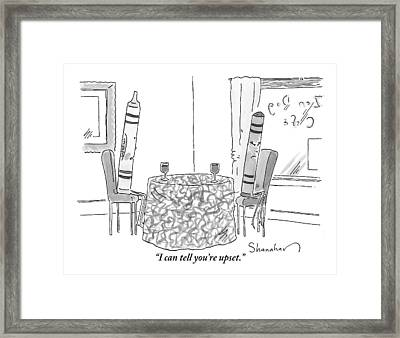 Two Crayons Sit Across From Each Other At A Round Framed Print by Danny Shanahan