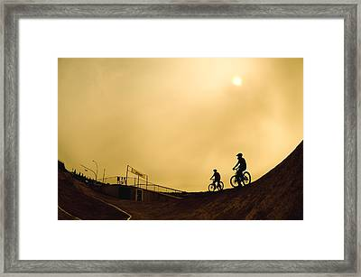 Two Cyclists Framed Print by Corey Hochachka