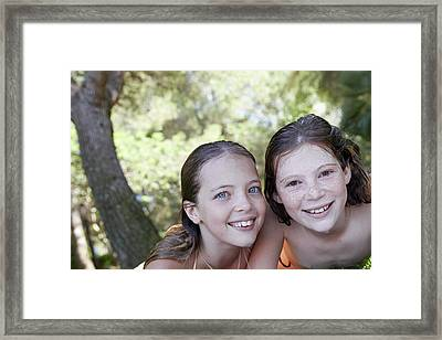 Two Girls Smiling Framed Print by Ruth Jenkinson