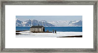 Two Hikers Standing On The Beach Framed Print by Panoramic Images