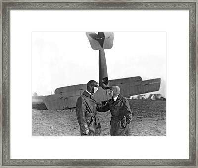 Two Pilots And A Plane Crash Framed Print by Underwood Archives