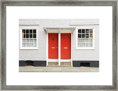 Two Red Doors Framed Print by Chevy Fleet
