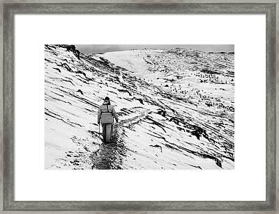 two tourists walking along ridge at hannah point penguin colony Antarctica Framed Print by Joe Fox