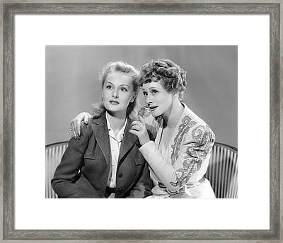Two Women Softly Talking Framed Print by Underwood Archives