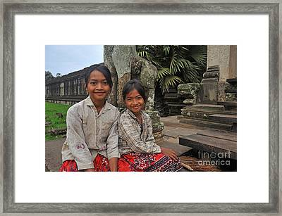 Two Young Cambodian Girls In Angkor Wat Framed Print by Sami Sarkis