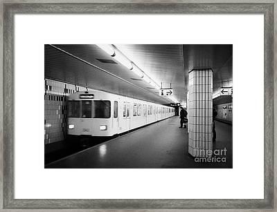 u-bahn train pulling in to ubahn station Berlin Germany Framed Print by Joe Fox