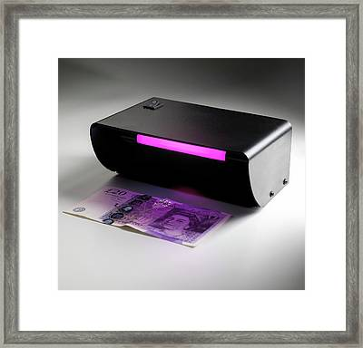 Ultraviolet Banknote Checker Framed Print by Science Photo Library