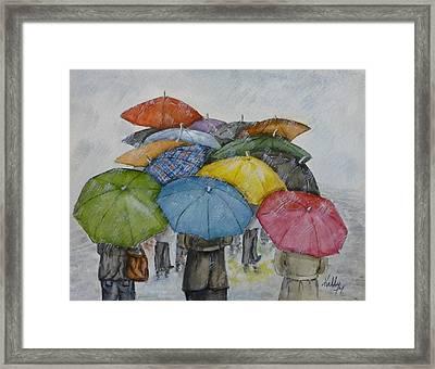 Umbrella Huddle Framed Print by Kelly Mills