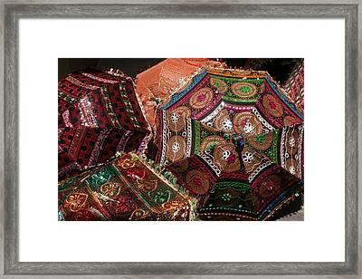 Umbrellas In The Textile Souk  Framed Print by Kathy Peltomaa Lewis
