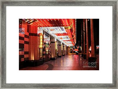 Under The Neon Lights Framed Print by John Rizzuto