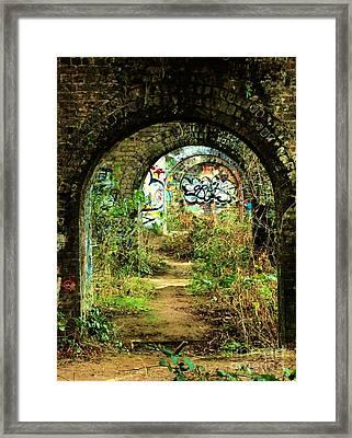 Underneath The Railway Arches Framed Print by C Lythgo