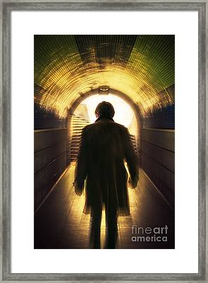 Underpassing Man Framed Print by Carlos Caetano