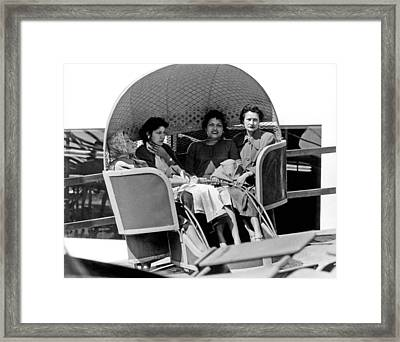 Unhappy Carnival Riders Framed Print by Underwood Archives