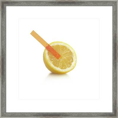 Universal Indicator Test On A Lemon Framed Print by Science Photo Library