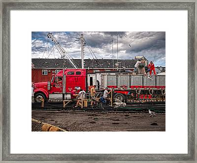 Unloading Fish And Mending Nets Framed Print by Bob Orsillo