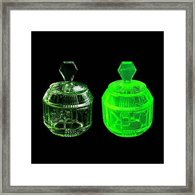 Uranium Glass Fluorescing Framed Print by Science Photo Library