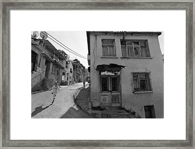 Urban Decay And Children Framed Print by Ilker Goksen