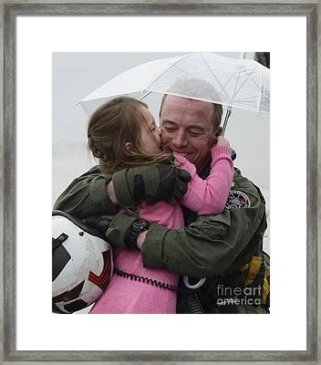 U.s. Aviator Hugs His Daughter Framed Print by Stocktrek Images