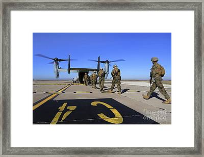 U.s. Marines And Sailors Board An Framed Print by Stocktrek Images