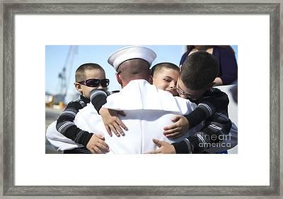 U.s. Navy Sailor Embraces His Sons Framed Print by Stocktrek Images