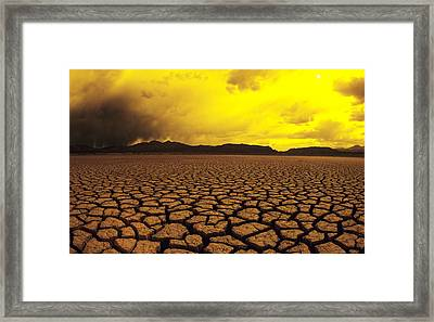 Usa, California, Cracked Mud In Dry Framed Print by Larry Dale Gordon